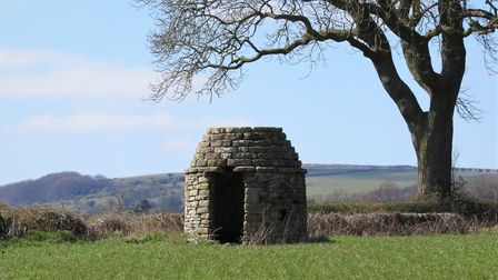 Pepperpot building in a corner of a field