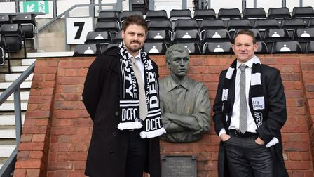Ben Adwick and Paul Broesmith by the bronze statue of Steve Bloomer next to the home dug-out at Pride Park Stadium