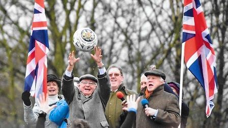 Willie Tucker gets the annual Royal Shrovetide Football match underway in Ashbourne