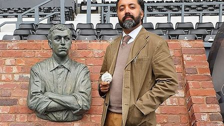 Kalwinder next to the Steve Bloomer bust next to the Pride Park pitch