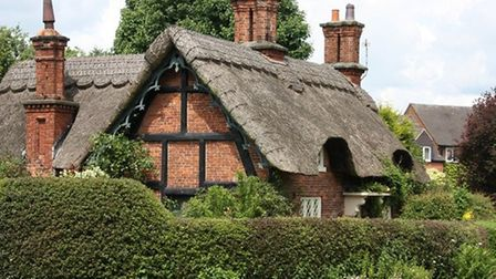 Thatched cottage by the pond in Osmaston by Sally Mosley