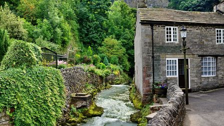 Stone built cottage by a river in the village of Castleton (c) Khrizmo/Getty Images/iStockphoto