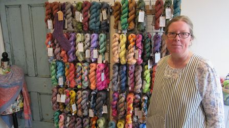 Carrie Warr amongst her colourful creations
