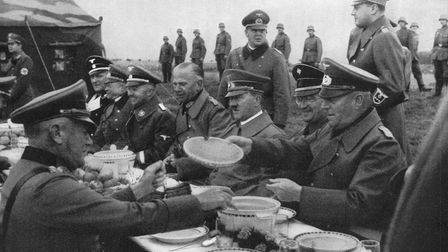 Nazi leader Adolf Hitler dines alfresco with a group of generals, circa 1940
