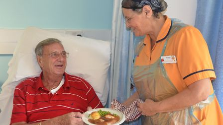 A patient is served a meal before lockdown.