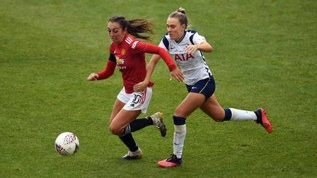 Tottenham Hotspurs' Josie Green (right) and Manchester United's Katie Zelem during the FA Women's Su