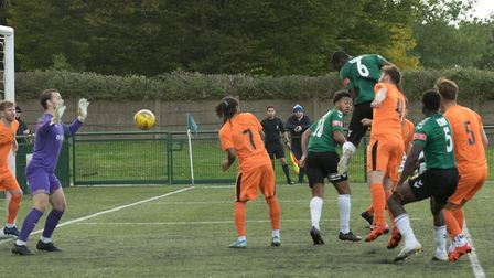 Toby Byron climbs highest and directs his header goalwards to increase Hendon's lead to three (Pic: