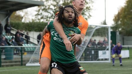 Dwade James gets a hug from a Hartley Wintney defender, which goes unpunished (Pic: DBeech Photograp
