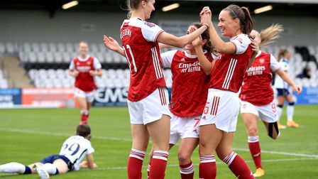 Arsenal's Vivianne Miedema (left) celebrates scoring her side's second goal of the game with her tea
