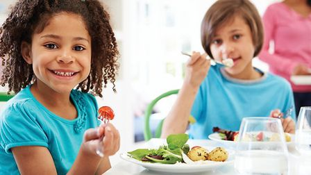 Stock image of children eating lunch. Picture Brent Council