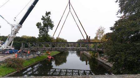 The Barnes Construction crew installing a temporary bridge over the River Cam at Clare College in Ca