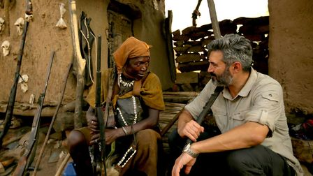 Reza Pakravan with a Malian hunter who is helping to defend his people from terrorism. Picture: Reza