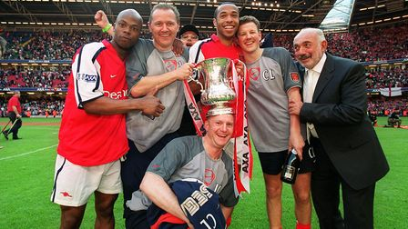 Thierry Henry and Sylvain Wiltord celebrate the Arsenal victory with staff (Gary Lewin, Joel Harris,