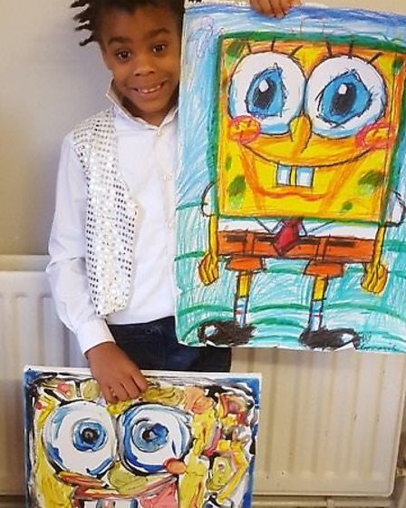 Genesis Brown, 8, has two exhibitions showcasing his art. Picture: Sandra Bee