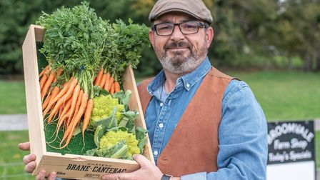 Ben Goodrum with some of his organic produce at the opening of his new farm shop. Picture: SARAH LUCY BROWN