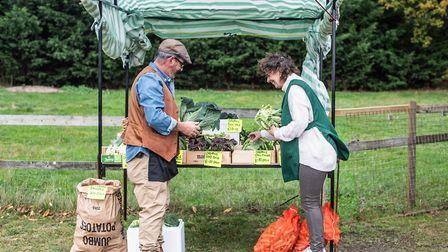 Ben Goodrum and Suzanne Dakin setting up the produce at the new farm shop. Picture: SARAH LUCY BROWN