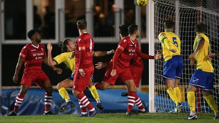 Charlie Edwards of Wingate & Finchley scores the second goal for his team during Hornchurch vs Winga