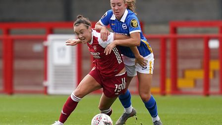 Arsenal's Caitlin Foord (left) and Brighton & Hove Albion's Maya Le Tissier battle for the ball duri