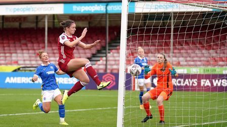 Arsenal's Lotte Wubben-May scores her side's fourth goal of the game during the FA Women's Super Lea