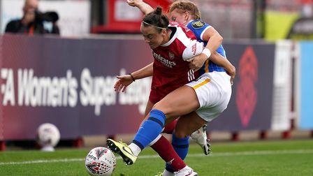 Arsenal's Katie McCabe (left) and Brighton and Hove Albion's Inessa Kaagman battle for the ball duri