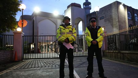 Police stand watch outside of the London Central Mosque in Regent's Park in February. Picture: PA