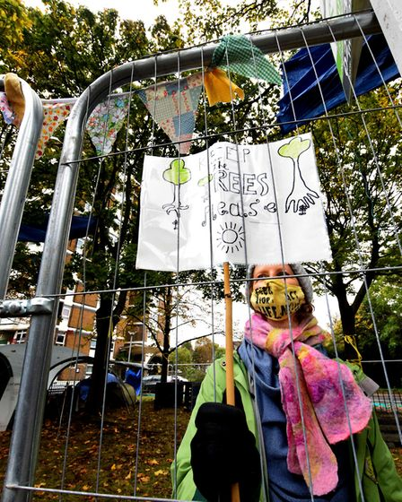 Protesters at the Dixon Clark Court tree encampment pin drawings done by local children to the outsi
