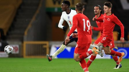 England's Eddie Nketiah (left) scores his side's second goal of the game during the UEFA Euro 2021 U