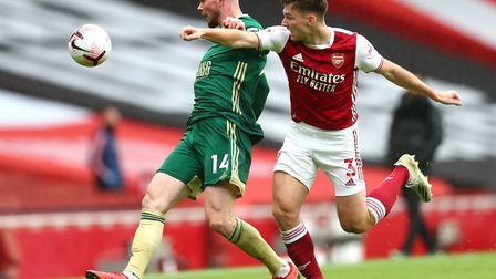 Sheffield United's Oliver Burke (left) and Arsenal's Kieran Tierney battle for the ball