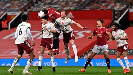Manchester United's Paul Pogba and Arsenal's Hector Bellerin (no.2) compete for a header during the