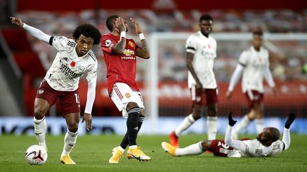Arsenal's Willian (left) on the ball during the Premier League match at Old Trafford, Manchester.