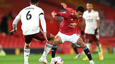 Manchester United's Mason Greenwood (right) and Arsenal's Gabriel Magalhaes battle for the ball duri
