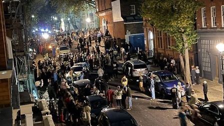 Hundreds spill into Downshire Hill during an unlicensed music event at the old Hampstead Police Stat