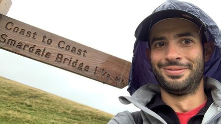 James Fox fighting the weather on his 192-mile walk. Picture: James Fox