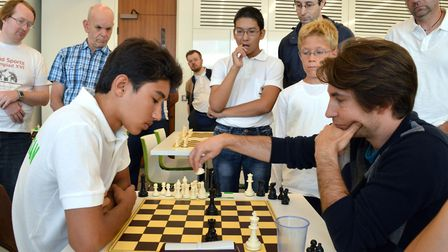 Mind Sports Olympiad organiser Etan Ilfeld (right) in a chess match with Shanepes Meredov (15) - a