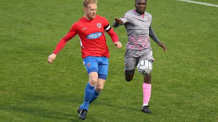 Kenny Clark of Dagenham and Redbridge and Moses Emmanuel of Wealdstone during Dagenham & Redbridge v