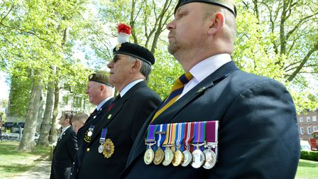 Members of the Islington Veterans Association stand to attention during an Anzac Day remembrance eve