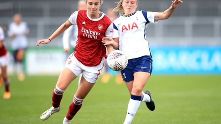 Arsenal's Vivianne Miedema (left) and Tottenham Hotspur's Anna Filbey battle for the ball during the