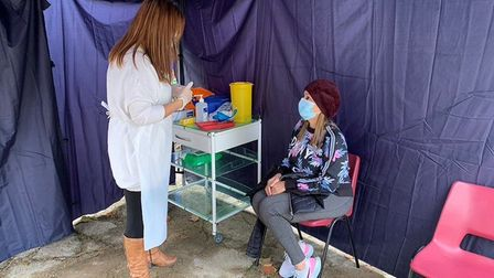 A gazebo for flu jabs set up outside Staverton Surgery in Willesden. Picture: Age UK