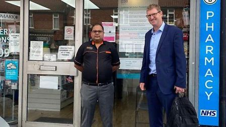 Mark Page (Christie & Co), right, with new buyer Raman Gangwar Picture: CHRISTIE AND CO