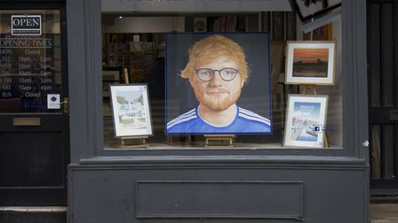The portrait sits in the window of MF Gallery Picture: OWEN BERRY