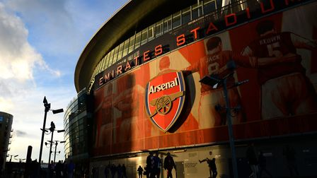 Fans walk outside Emirates Stadium. Photo by Michael Regan/Getty Images