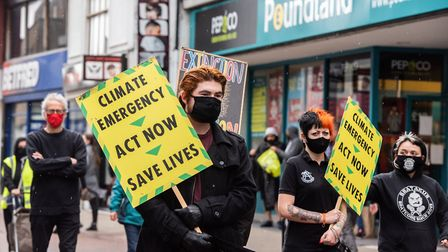 Extinction Rebellion protestors carried signs warning poeple to act now and save lives Picture: SARA