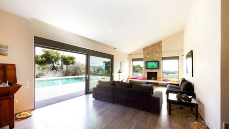 Tramonto di Olive's spacious lounge, which opens out onto the poolside. Picture: Villa Rentals