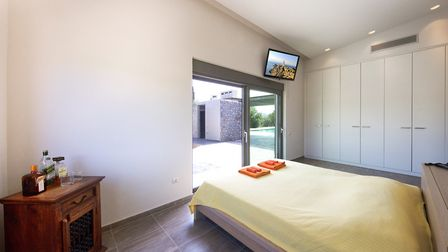 Tramonto di Olive's master bedroom - one of four bedrooms at the spacious villa. Picture: Villa Rent