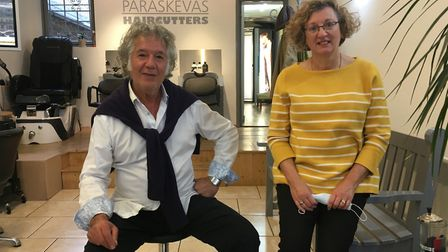 Johnny Paraskevas, owner of Paraksevas Haircutters in Park Parade with customer Alison Lee. Picture: Nathalie Raffray