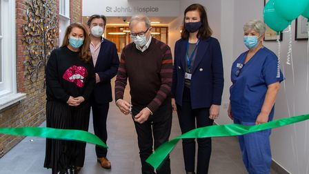 Relatives of a former patient cut the ribbon on the newly refurbished inpatient unit at St Johns Hos