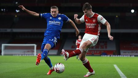 Leicester City's Timothy Castagne (left) and Arsenal's Kieran Tierney battle for the ball