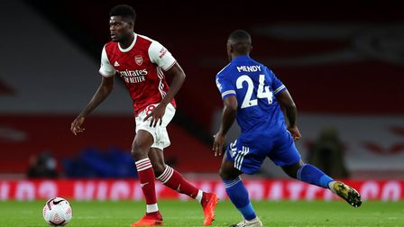 Arsenal's Thomas Partey (left) and Leicester City's Nampalys Mendy battle for the ball
