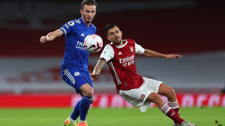 Leicester City's James Maddison (left) and Arsenal's Dani Ceballos battle for the ball