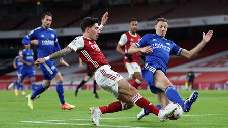 Arsenal's Hector Bellerin and Leicester City's Jonny Evans (right) battle for the ball